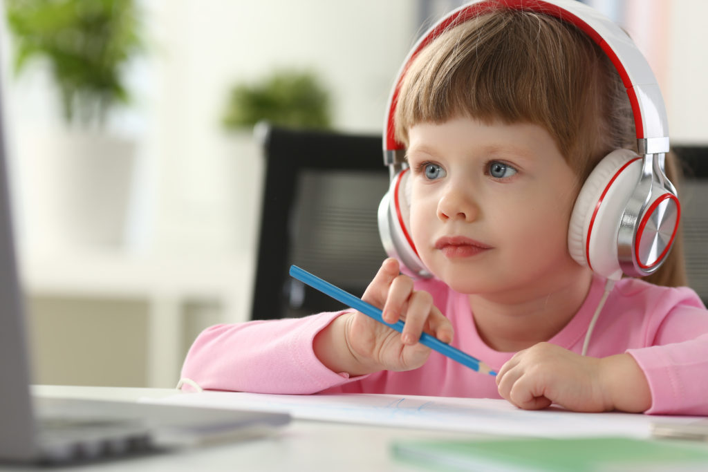 little girl listening audiobooks adhd dyslexia